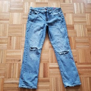 Distressed jeans with paint splatter